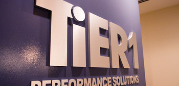 A photo of the TiER1 Performance Solutions office wall